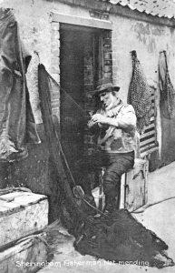 Sheringham fishermen net mending